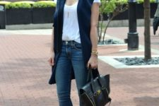 04 blue skinnies, a white tee, a navy long vest, perforated nude mules