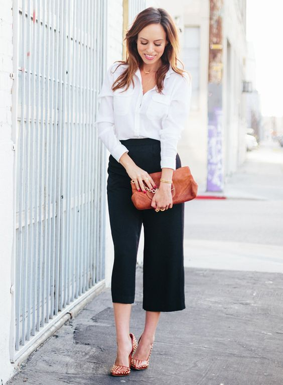 update a usual black and white look wearing a white button down, black culottes, printed shoes and a camel bag