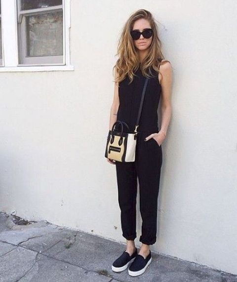 a black jumpsuit, black slipons and a black and white bag for a comfy modern work look