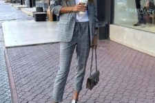 05 a grey plaid pantsuit with cropped pants, a white tee, white sneakers is a comfy work casual look