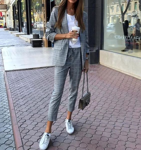 a grey plaid pantsuit with cropped pants, a white tee, white sneakers is a comfy work casual look