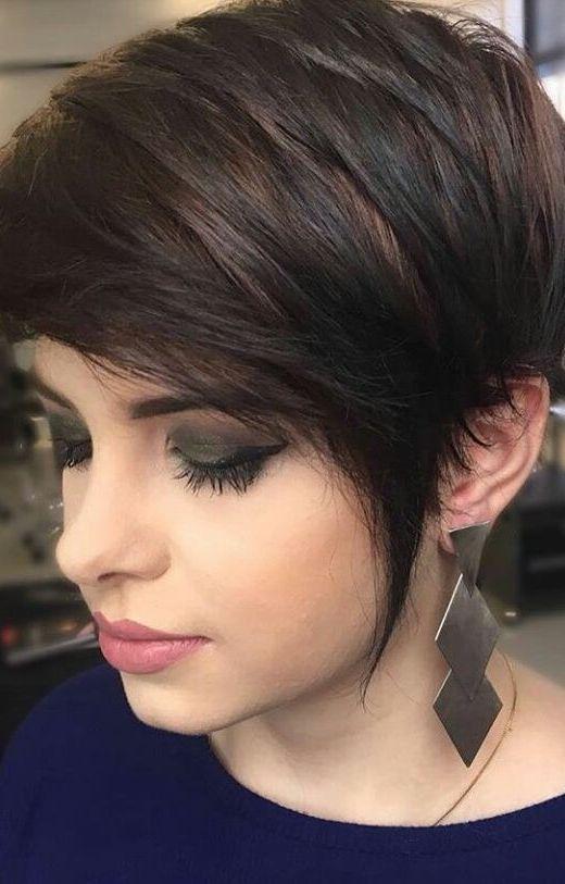 a long dark pixie haircut with black balayage on chestnut hair