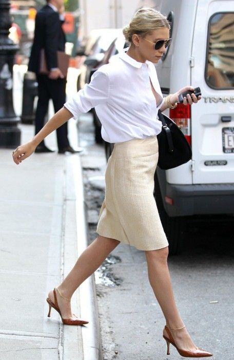 a neutral knee skirt, a white shirt, cognac-colored sling back kitten heel