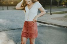 05 a white tee, a rust-colored suede button down skirt and grey lace up shoes