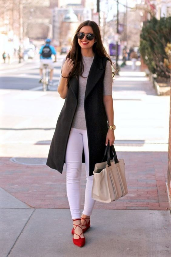 white jeans, a grey tee, a black long vest, red lace up flats for a bold and catchy look