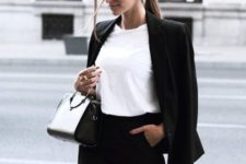 06 a black pantsuit, a white tee and a small black bag feel like minimalist chic