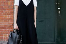 06 a white polo shirt, a black slip dress over it, white sneakers and a comfy bag