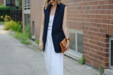 06 a white strapless jumpsuit with wide leg pants, a navy long vest and a mustard clutch