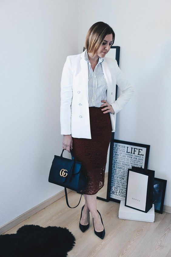 a white striped shirt, a white blazer, a burgundy lace midi skirt, black kitten heels and a black bag