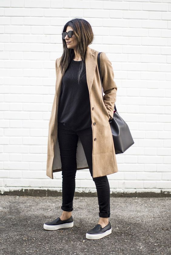 black skinnies, a black top, black slipons and a tan trench for a comfy spring work look