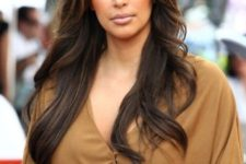 07 Kim Kardashian wearing long brown cascading hair with highlights to give it more dimension