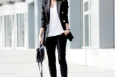 07 a black pantsuit with cropped pants, a white top, white sneakers and a black bag for a casual feel