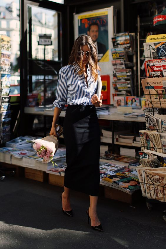 a blue and white striped shirt, a black pencil midi skirt, black heels for a simple work look