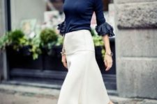 07 a navy blouse with ruffled sleeves, a creamy midi skirt with an A-silhouette and black kitten heels