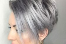 07 a pixie bob wiht long side bangs in trendy grey hair color looks chic
