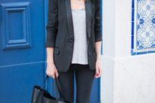 07 black skinnies, a grey tee, a black blazer, leopard print slipons and a large bag for a cusal work look