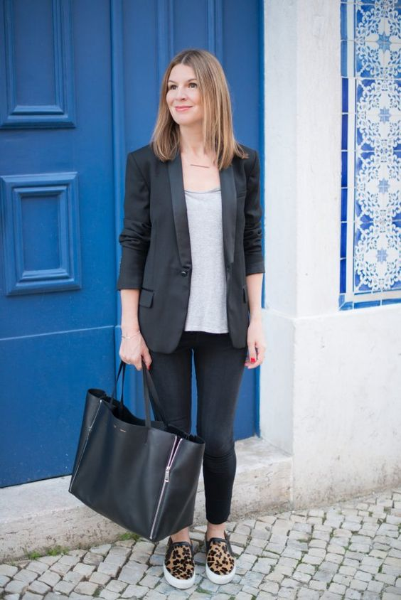 black skinnies, a grey tee, a black blazer, leopard print slipons and a large bag for a cusal work look