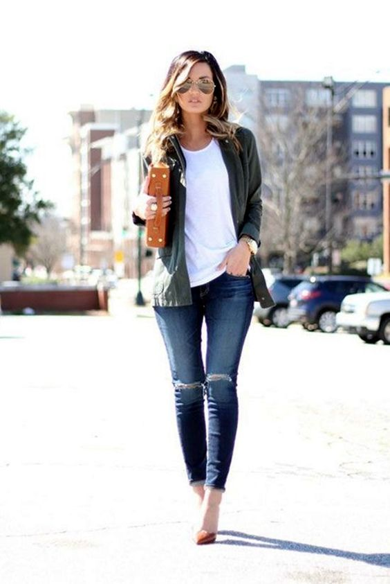 ripped jeans, a white tee, an olive green shirt, tan heels and a bag