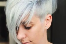08 a longer pixie haircut with a side fringe and a chic blue to white balayage