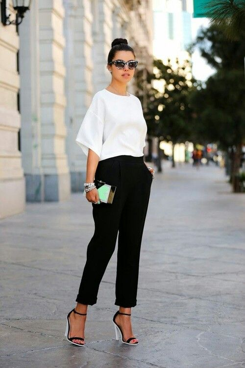 black pants, a white tee with wide sleeves, black and white heels for a minimalist work outfit