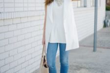 blue skinnies, a white top, a white long vest, layered necklaces and white shoes for a clean look