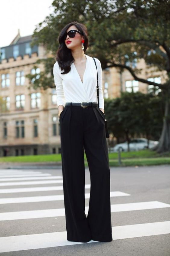 this simple look is spruced up with wide pants, a dreaped shirt and statement earrrings with a red touch