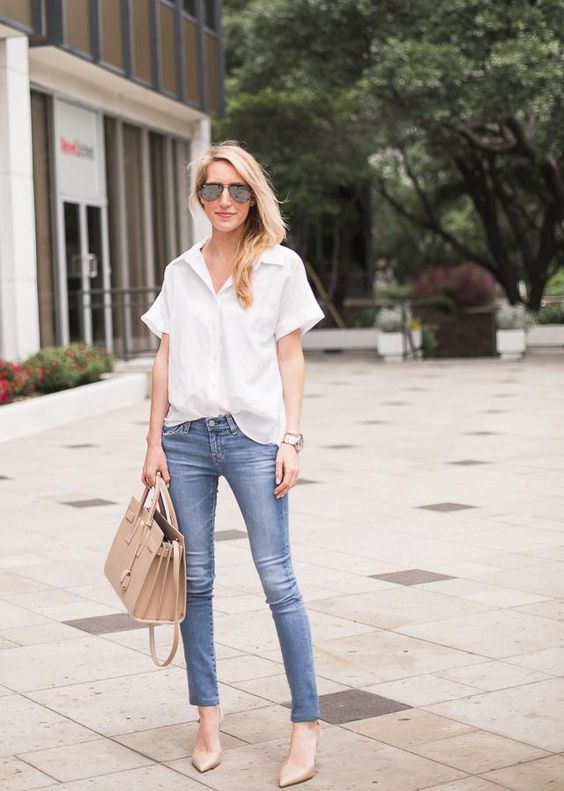 a white button down, blue skinnies, nude shoes and a neutral bag for a casual work look