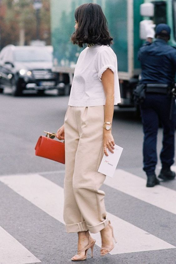 a white tee, neutral culottes, nude shoes and a bold bag for a smart casual work outfit