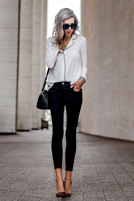 cropped pants, a pyjama white and black shirt, black heels and a black bag