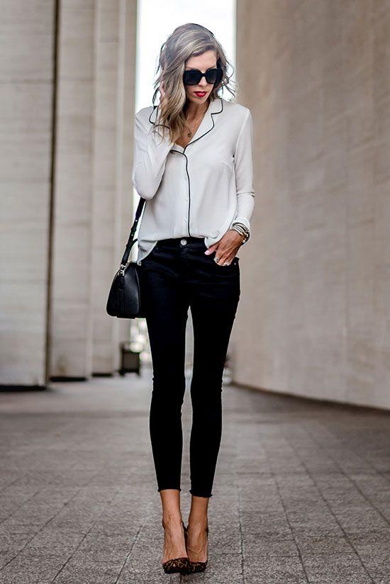 cropped pants, a pyjama white and black shirt, black heels and a black bag