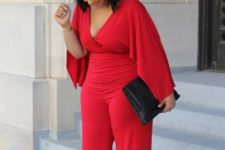 10 a gorgeous red jumpsuit with wide sleeves, a deep V-neckline and wide pants to show off all the curves