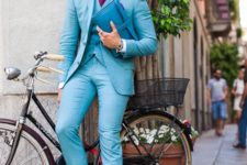 10 a turquoise three-piece suit, a plum-colored tie and white sneakers for a different look
