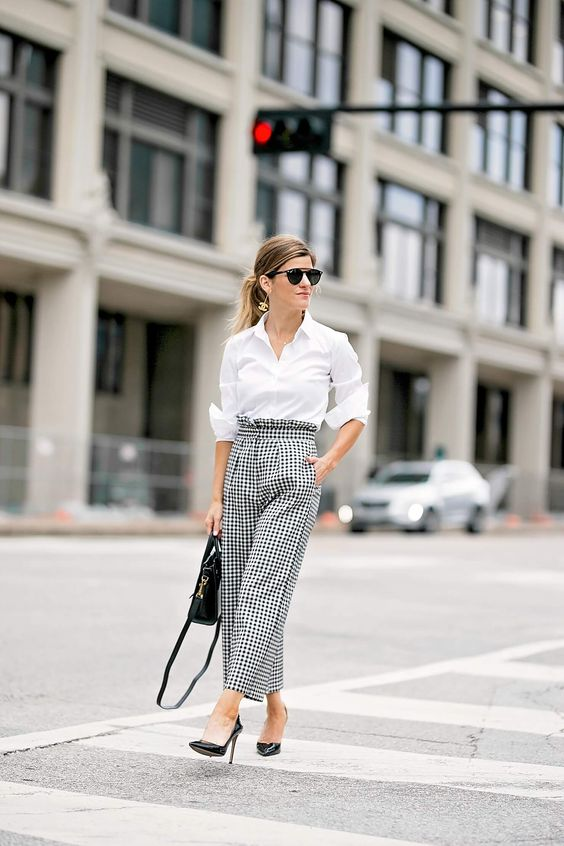 a white button down, checked high waisted wide pants, black shoe sand a bag