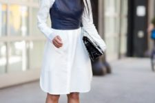 10 a white shirtdress, a black leather top on it, a black bag and bag for a catchy look