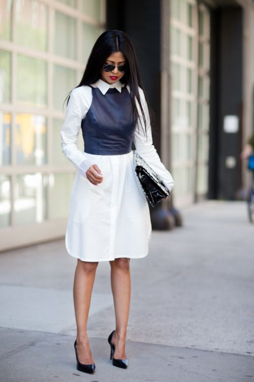 a white shirtdress, a black leather top on it, a black bag and bag for a catchy look