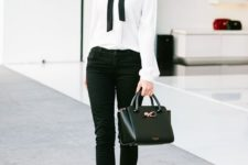 10 black jeans, a white blouse with a black bow, black heels and a comfy bag
