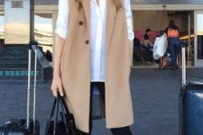 10 black leggings, a white shirt, black slipons, a tan long vest and a large black bag for a casual feel
