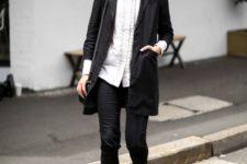 10 black skinnies, a white button down, a black long blazer, black slipons for a monochrome look