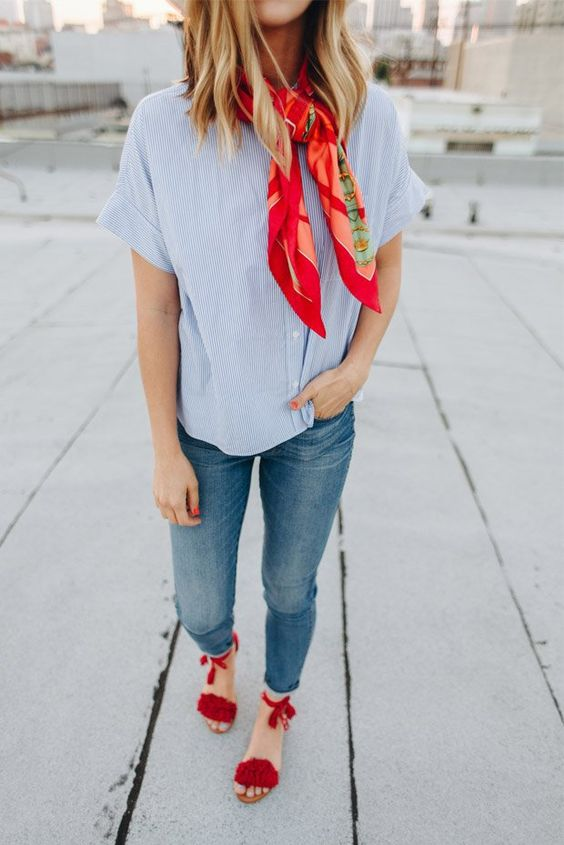 blue skinnies with a raw hem, a thin stripe shirt, red pompom shoes and a red scarf for a colorful touch
