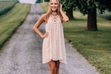 11 a blush lace dress with a cutout neckline, no sleeves and blush lace up shoes