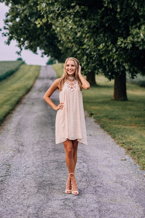 a blush lace dress with a cutout neckline, no sleeves and blush lace up shoes