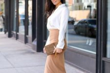 11 a chic look with a white button down, a tan wrap pencil skirt, tan shoes and a clutch
