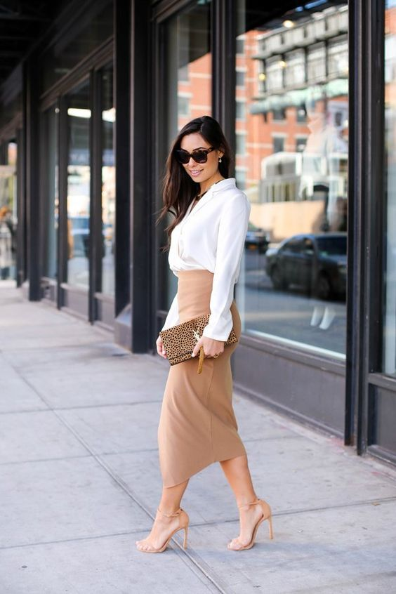 a chic look with a white button down, a tan wrap pencil skirt, tan shoes and a clutch