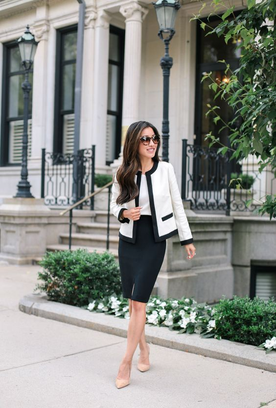 a classic black and white look with a black knee skirt, a white top, a black and white jacket and nude shoes