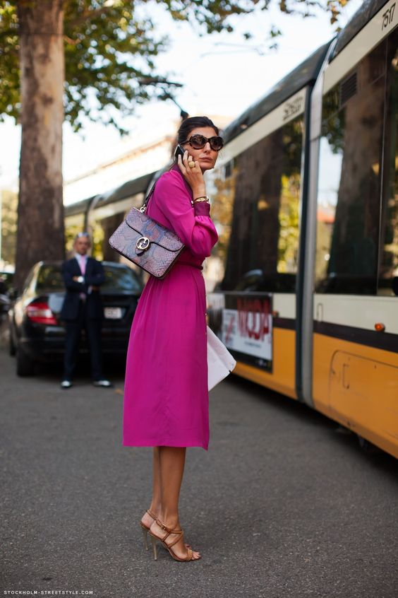 a deep purple shirtdress, a bold bag with a snake print, tan shoes