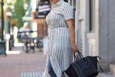 11 a striped shirtdress, blue ripped skinnies, flats and a black bag