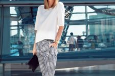 11 a white tee, black and white windowpane pants, black ankle strap shoes and a clutch