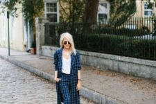 11 a windowpane pnatsuit in navy and white with a long blazer, a white top and white kitten heel shoes