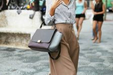 11 beige culottes, a striped shirt, black ankle strap shoes and a large bag