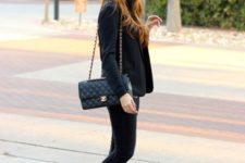 11 black jeans, a black jacket, black slipons and a comfy bag for a business casual look